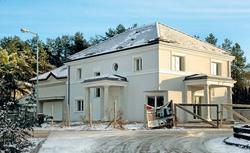 Nietypowa architektura domu pasywnego. Budynek pasywny w stylu pałacowym.